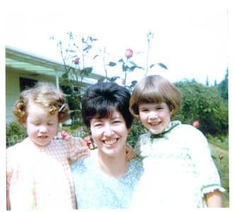 Woman with 2 young girls in garden