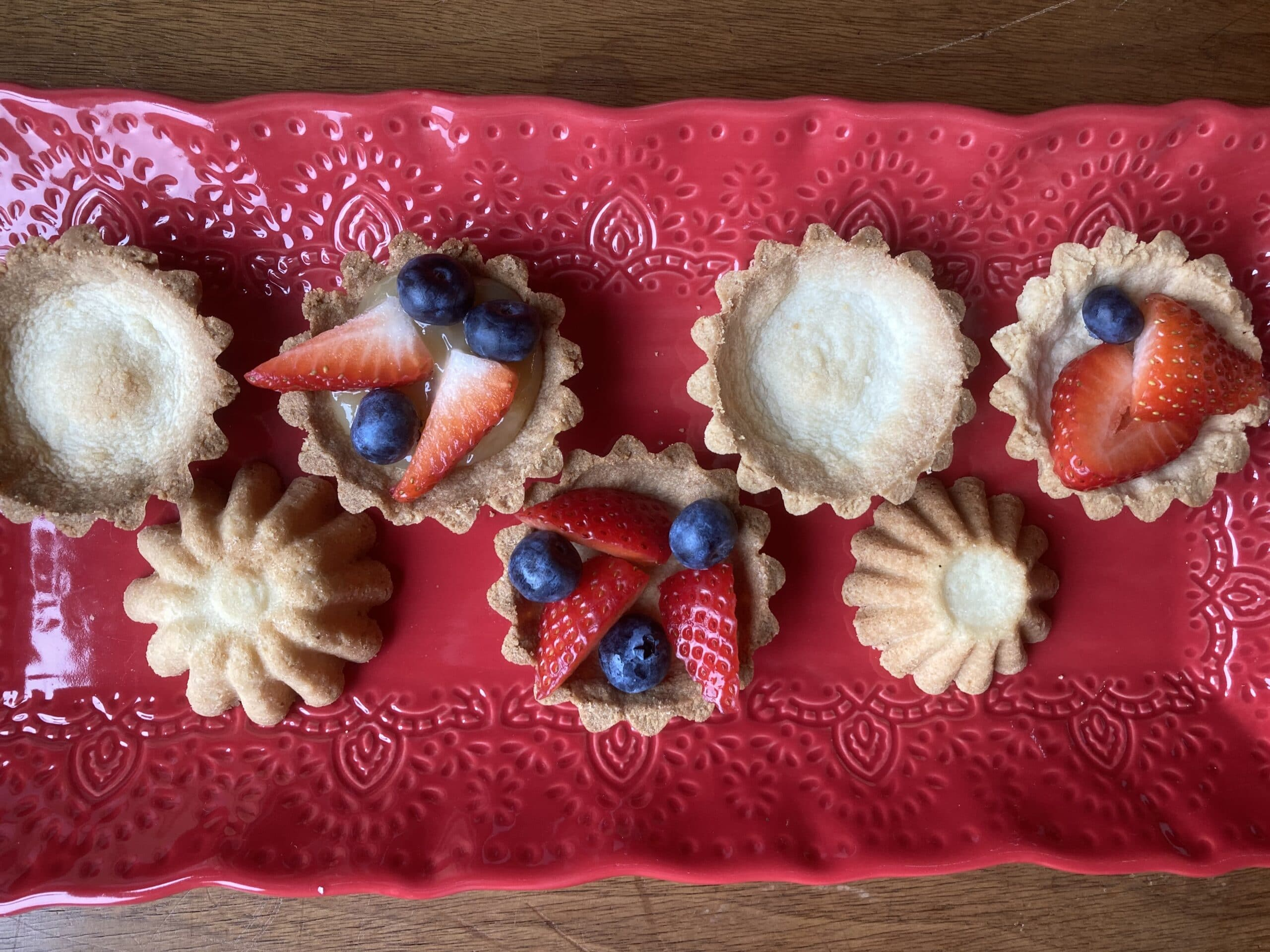 tart-like cookies on a red tray