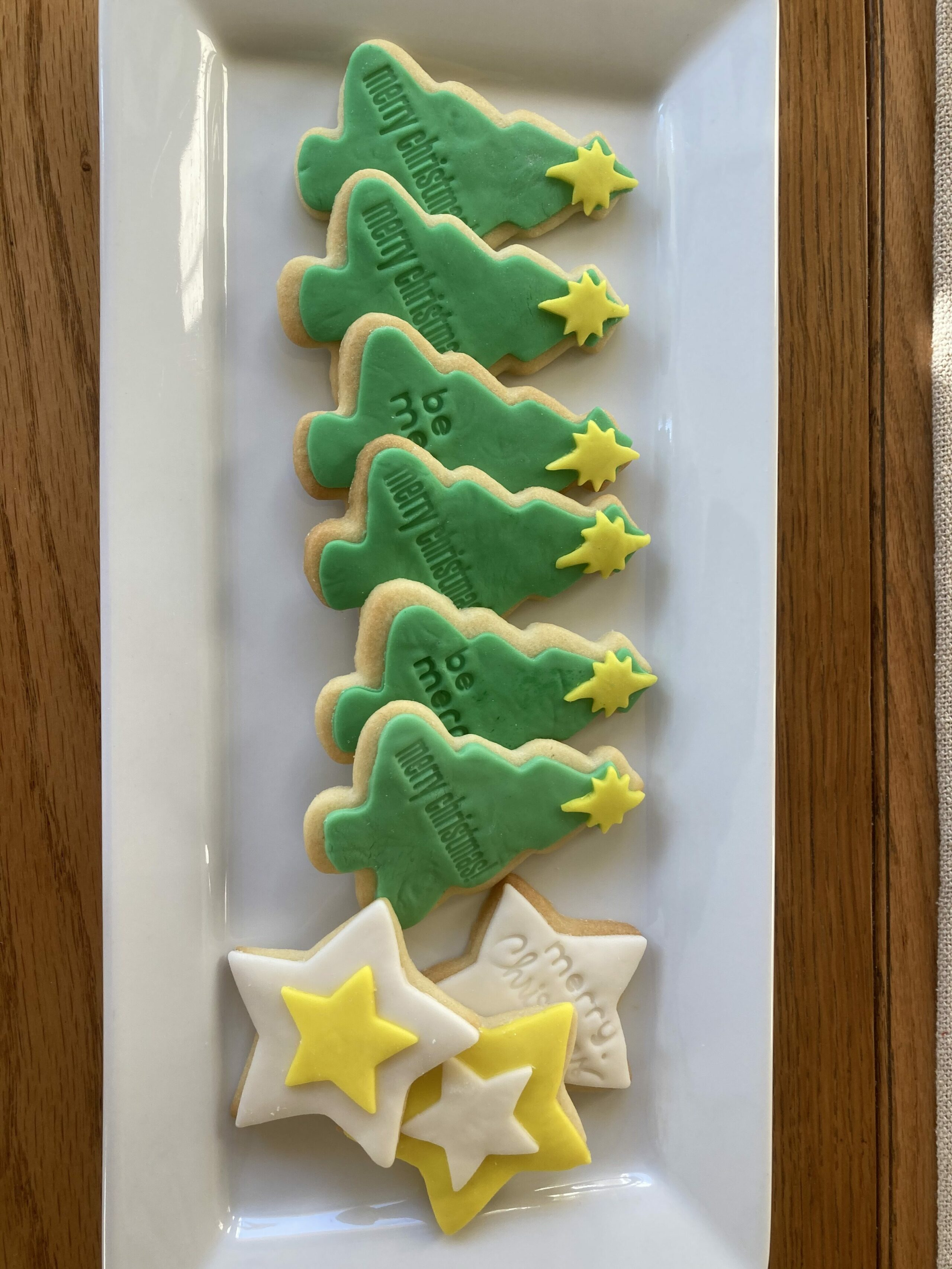 trees and star cookies on a tray
