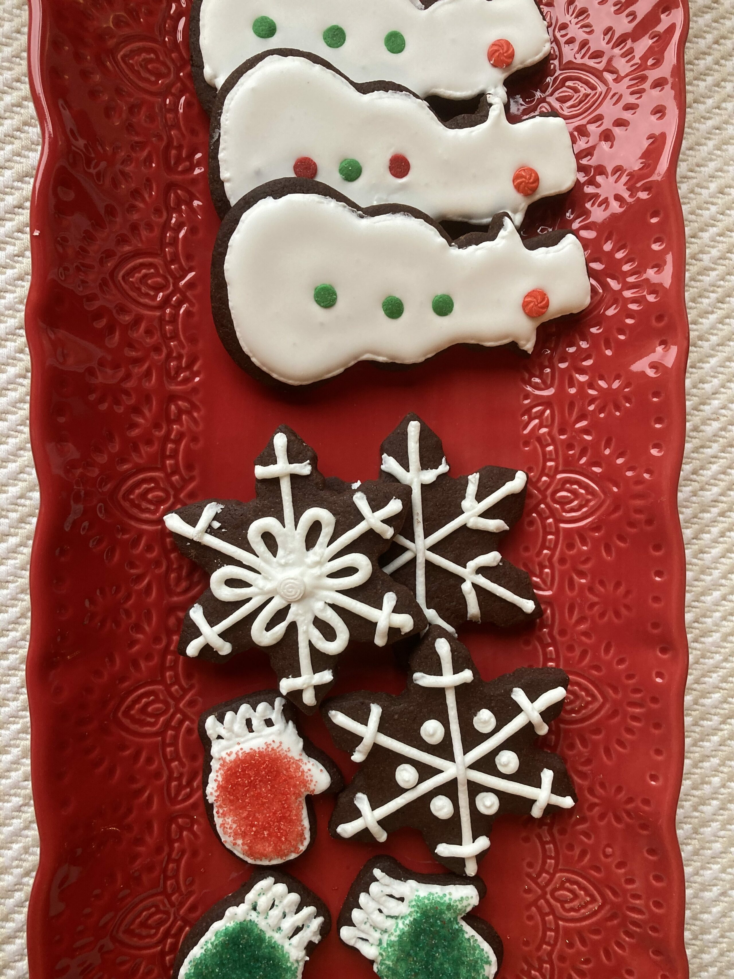 decorated chocolate cookies on red platter