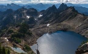 high mountain peaks and lake