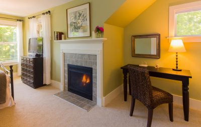 The fireplace is cozy and warm in one of the guest rooms at the Greenlake Guest House