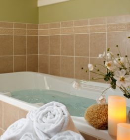 Parview Bathroom with a full tub and candle lit on the side of the tub for a relaxing weekend