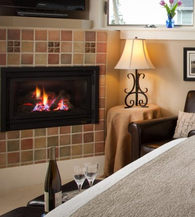 The Cascade room has a nice cozy fireplace turned on and neutral colors for the interior