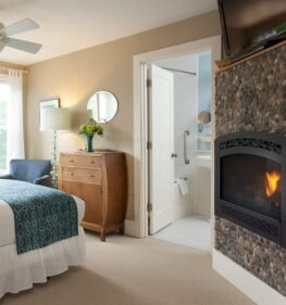 Green lake room has a toasty fireplace going with amazing light coming through the window