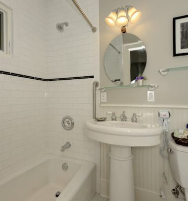 The bathroom inside the Ravena room is very clean and tiled white