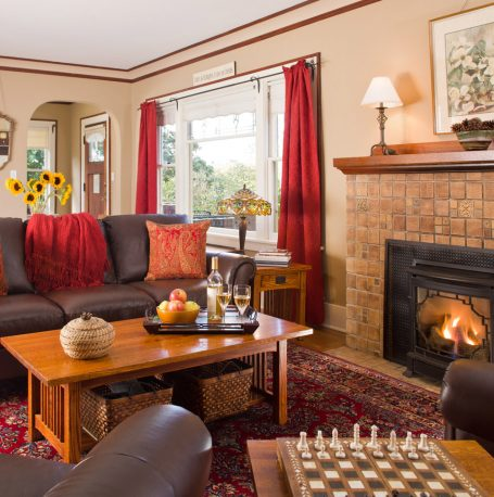A nice family room area is designed for comfort with a chess board and fireplace
