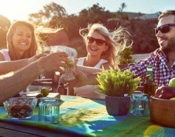 Friends enjoying a toast outside
