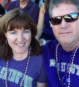 The Innkeeper and her husband at a sporting event wearing their teams color in support