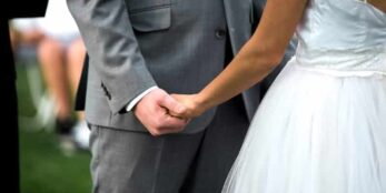 The innkeepers son holding hands with his newly married wife
