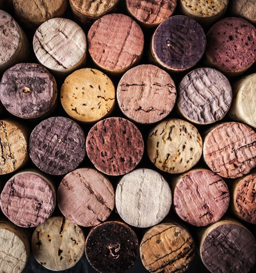 Wine corks of different colors all lined up