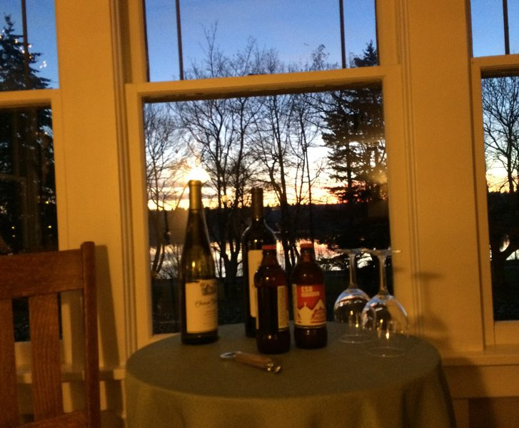 A table of different varieties of wine at dusk time outside