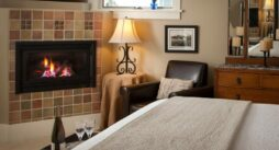 The cascade room has a warm fireplace on and the bed looks cozy