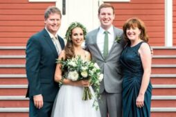 The innkeeper stands proudly with her two sons and new daughter in law at the wedding