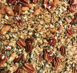 Granola up close with pecans and other pieces to start your day off right