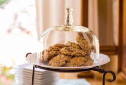 Cookies in a glass receptacle are fresh baked with love and care from the innkeeper