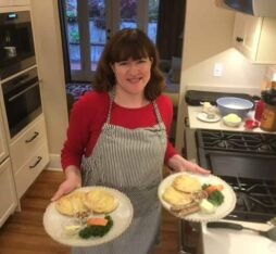 Julie the innkeeper making breakfast in the kitchen for her guests