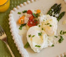 Poached eggs with vegetables and a glass of orange juice