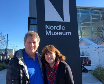 The innkeepers standing in front of the Nordic Museum in Seattle