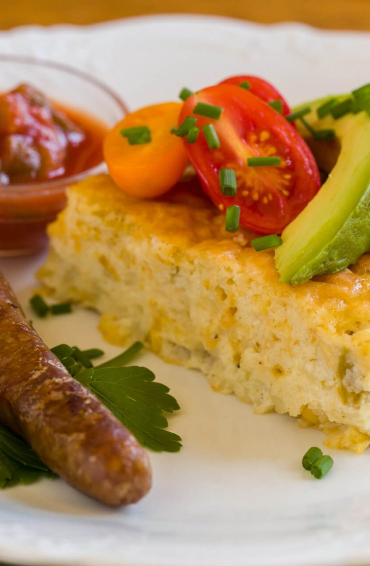 A delicious quiche with salsa and breakfast sausage right off the stove top