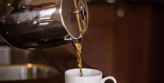 coffee being poured from stainless french press